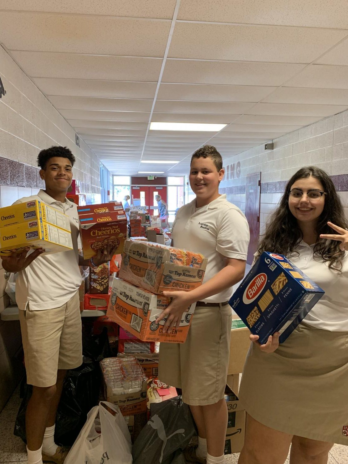 Spalding Students, Matthew Kostacopoulos '21, Nico Crofton '21 and Anna Karageorgi '21 sorting the canned goods.