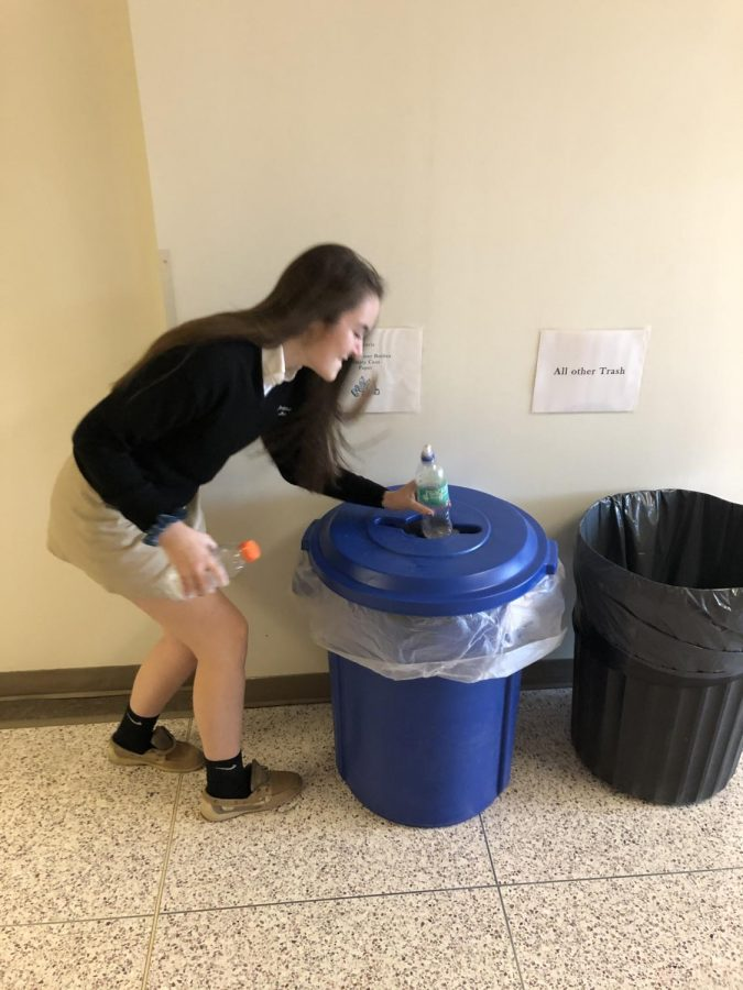 Kelly Quraishi '21 is using the Green Club recycling bins to tidy up the schools.